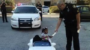 Pictured: A little girl who does not have a rearview mirror in the center of her vehicle.